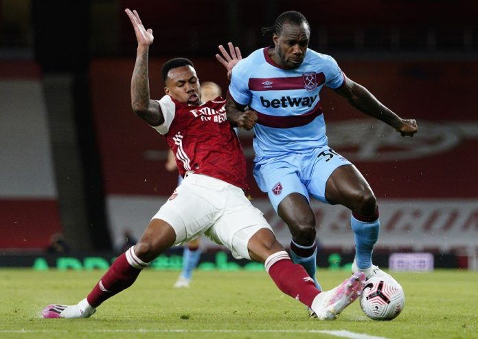 LONDON, ENGLAND - SEPTEMBER 19: Gabriel of Arsenal tackles Michail Antonio of West Ham United during the Premier League match between Arsenal and West Ham United at Emirates Stadium on September 19, 2020 in London, England. (Photo by Will Oliver - Pool/Getty Images)