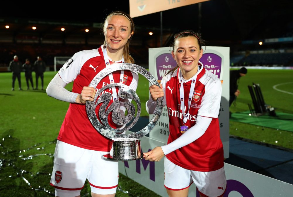 HIGH WYCOMBE, ENGLAND - MARCH 14: Louise Quinn and Katie McCabe of Arsenal women celebrate with the trophy after the WSL Continental Cup Final between Arsenal Women and Manchester City Ladies at Adams Park on March 14, 2018 in High Wycombe, England. (Photo by Catherine Ivill/Getty Images)