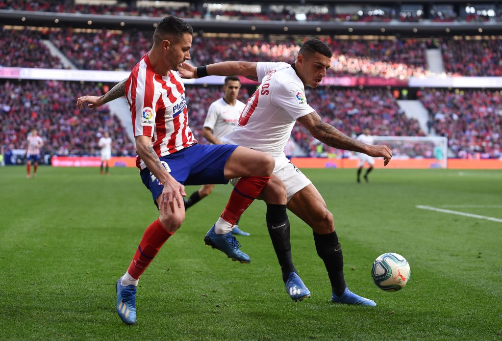 MADRID, SPAIN - MARCH 07: Vitolo of Atletico Madrid battles for possession with Diego Carlos of Sevilla FC during the Liga match between Club Atletico de Madrid and Sevilla FC at Wanda Metropolitano on March 07, 2020 in Madrid, Spain. (Photo by Denis Doyle/Getty Images)