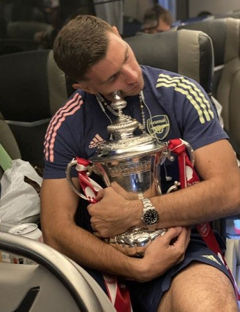 Emiliano Martinez, Arsenal goalkeeper, sleeps while hugging the FA Cup