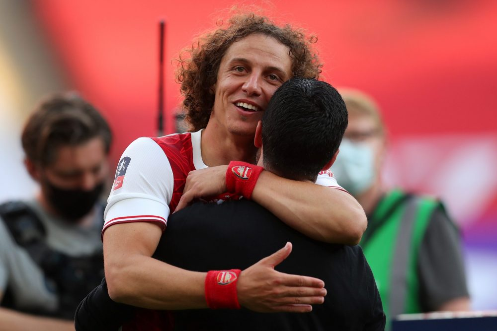 Arsenal's Spanish head coach Mikel Arteta (R) celebrates with Arsenal's Brazilian defender David Luiz during the English FA Cup final football match between Arsenal and Chelsea at Wembley Stadium in London, on August 1, 2020. - Arsenal won the match 2-1. (Photo by Catherine Ivill / POOL / AFP)