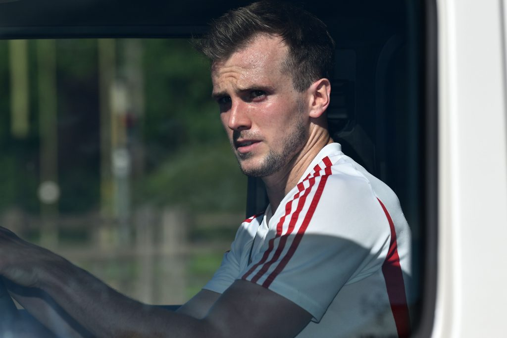 Arsenal's English defender Rob Holding leaves Arsenal's Colney training centre north of London on May 20, 2020 as training continues for Premier League clubs with a June re-start the intention during the COVID-19 pandemic. - Teams have started socially-distanced training in small groups this week, but several Premier League stars have expressed concerns about plans to resume the season. (Photo by Glyn KIRK / AFP)