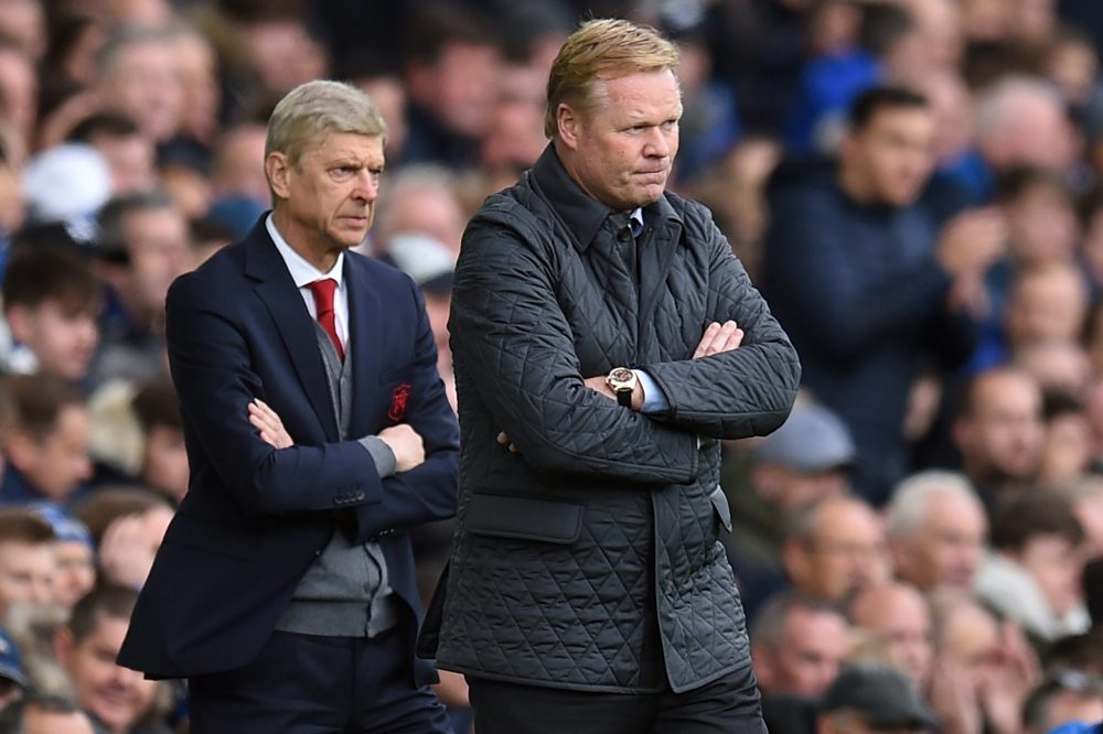 Arsenal's French manager Arsene Wenger (L) and Everton's Dutch manager Ronald Koeman (R) watch from the touchline during the English Premier League football match between Everton and Arsenal at Goodison Park in Liverpool, north west England on October 22, 2017. / AFP PHOTO / Oli SCARFF