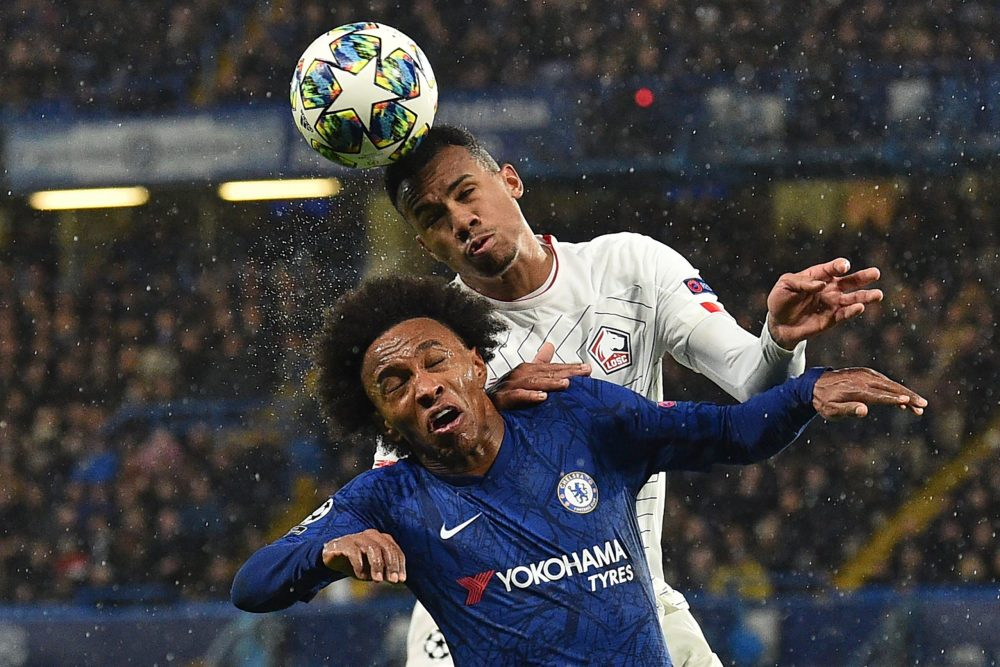Future Arsenal teammates? Chelsea's Brazilian midfielder Willian (L) vies with Lille's Brazilian defender Gabriel dos Santos Magalhaes during the UEFA Champion's League Group H football match between Chelsea and Lille at Stamford Bridge in London on December 10, 2019. (Photo by Glyn KIRK / AFP)