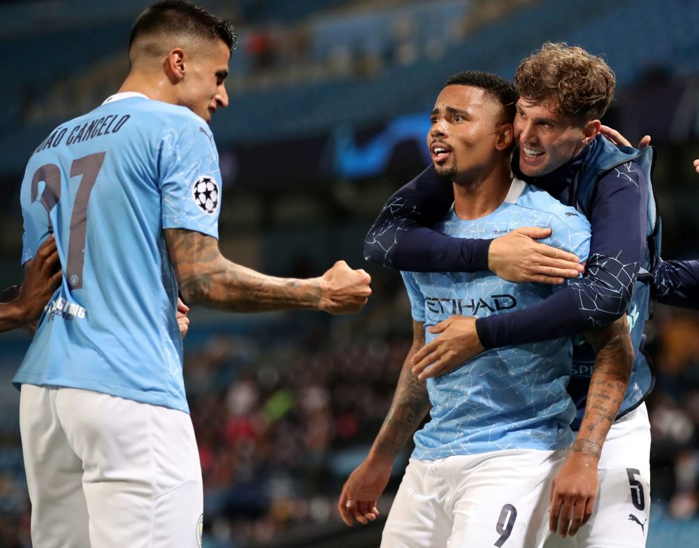 Manchester City's Brazilian striker Gabriel Jesus (C) celebrates scoring his team's second goal during the UEFA Champions League round of 16 second leg football match between Manchester City and Real Madrid at the Etihad Stadium in Manchester, north west England on August 7, 2020. (Photo by Nick Potts / POOL / AFP) (Photo by NICK POTTS/POOL/AFP via Getty Images)