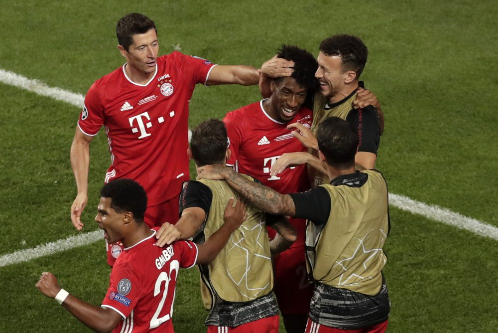 Bayern Munich's French forward Kingsley Coman (C) celebrates with Bayern Munich's Polish forward Robert Lewandowski (Top L) and Bayern Munich's Croatian midfielder Ivan Perisic (Top R) after opening the scoring during the UEFA Champions League final football match between Paris Saint-Germain and Bayern Munich at the Luz stadium in Lisbon on August 23, 2020. (Photo by Manu Fernandez / POOL / AFP) (Photo by MANU FERNANDEZ/POOL/AFP via Getty Images)