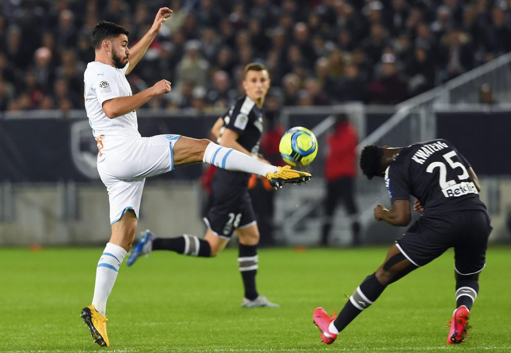 Morgan Sanson (L) fights for the ball with Bordeaux's French defender Enock Kwateng during the French L1 football match between Girondins de Bordeaux and Olympique de Marseille (OM) at the Matmut-Atlantique stadium in Bordeaux, southwestern France on February 2, 2020. (Photo by NICOLAS TUCAT / AFP)