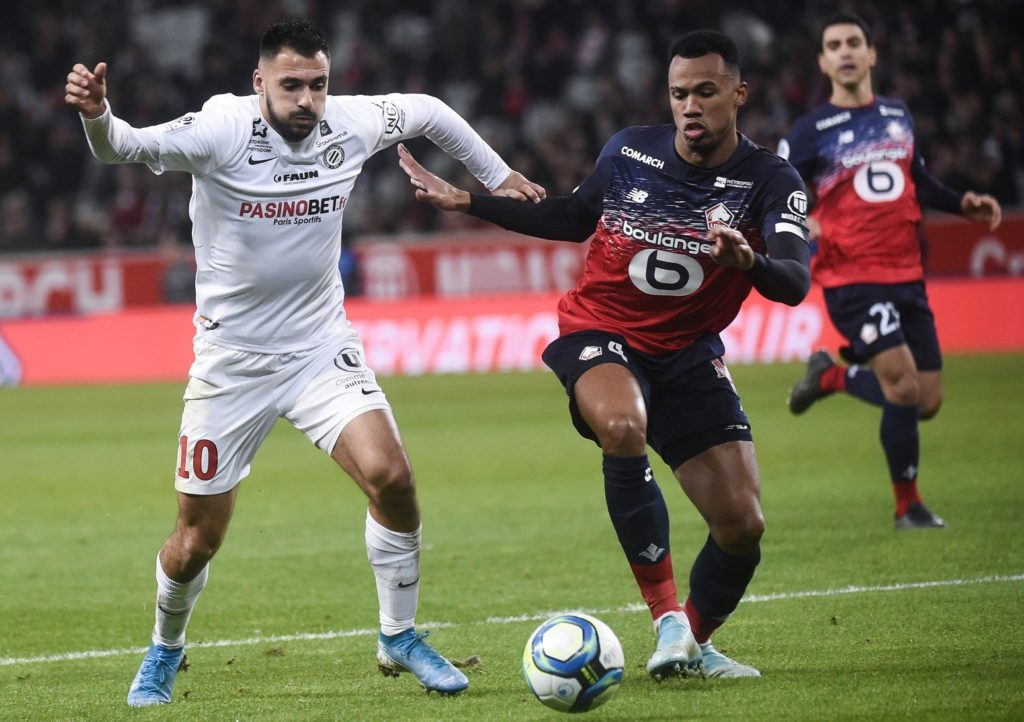Lille's Brazilian defender Gabriel dos Santos Magalhaes (R) fights for the ball with Montpellier's French forward Gaetan Laborde during the French L1 football match between Lille OSC (LOSC) and Montpellier Herault Sport Club (MHSC) at the Pierre Mauroy Stadium in Villeneuve-d'Ascq, on December 13, 2019. (Photo by FRANCOIS LO PRESTI / AFP)