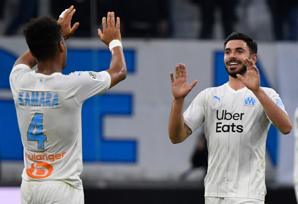 Morgan Sanson (R) celebrates after scoring a goal during the French L1 football match between Olympique de Marseille (OM) and Football Club de Nantes (FCN) at the Velodrome Stadium in Marseille, southern France, on February 22, 2020. (Photo by GERARD JULIEN / AFP)