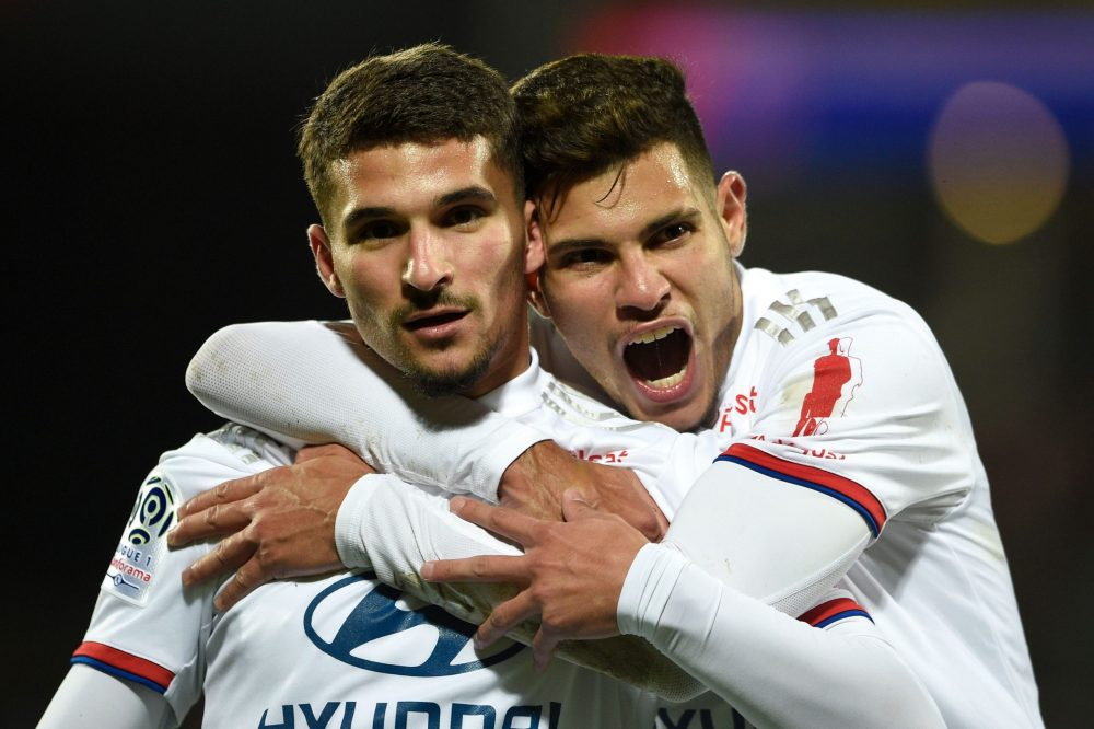 Lyon's French midfielder Houssem Aouar (L) celebrates after scoring a goal during the French L1 football match between Metz (FC Metz) and Lyon (OL) at Saint Symphorien stadium in Longeville-lès-Metz, eastern France, on February 21, 2020. (Photo by JEAN-CHRISTOPHE VERHAEGEN / AFP)
