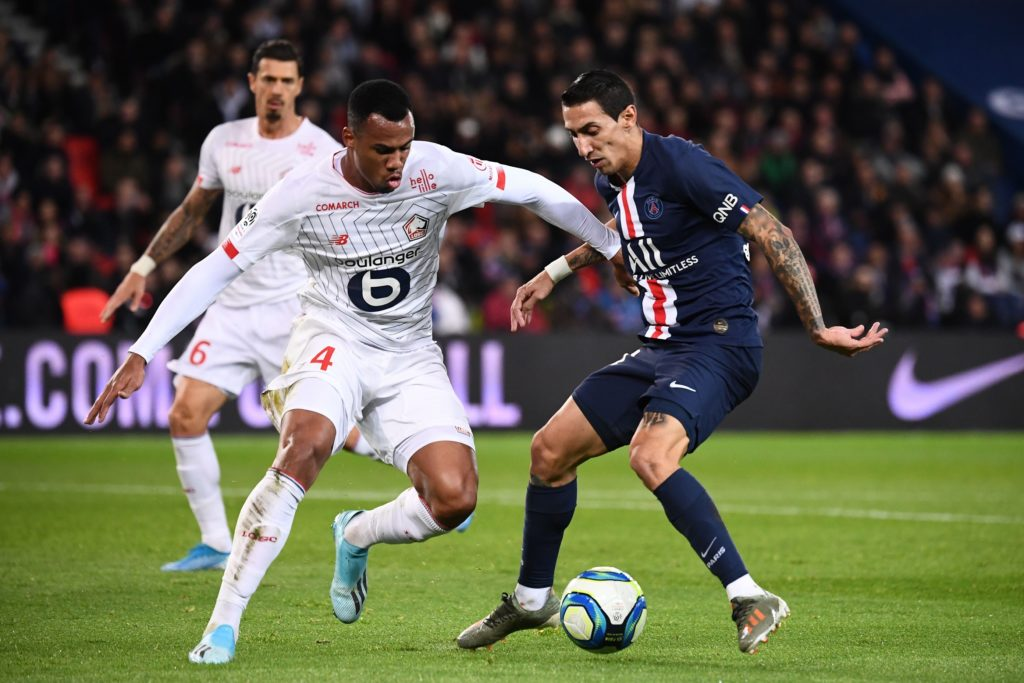 Lille's Brazilian defender Gabriel dos Santos Magalhaes (L) vies with Paris Saint-Germain's Argentine midfielder Angel Di Maria during the French L1 football match between Paris Saint-Germain (PSG) and Lille (LOSC) on November 22, 2019 at the Parc des Princes in Paris. (Photo by FRANCK FIFE / AFP) (Photo by FRANCK FIFE/AFP via Getty Images)