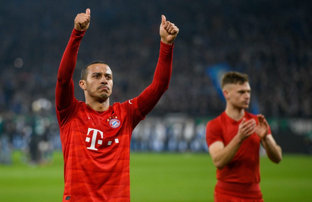 Bayern Munich's Spanish midfielder Thiago Alcantara (L) and Bayern Munich's German midfielder Joshua Kimmich celebrate after the German Cup (DFB Pokal) quarter-final football match Schalke 04 v FC Bayern Munich in Gelsenkirchen, western Germany on March 3, 2020. (Photo by SASCHA SCHUERMANN / AFP) / DFB REGULATIONS PROHIBIT ANY USE OF PHOTOGRAPHS AS IMAGE SEQUENCES AND QUASI-VIDEO. (Photo by SASCHA SCHUERMANN/AFP via Getty Images)