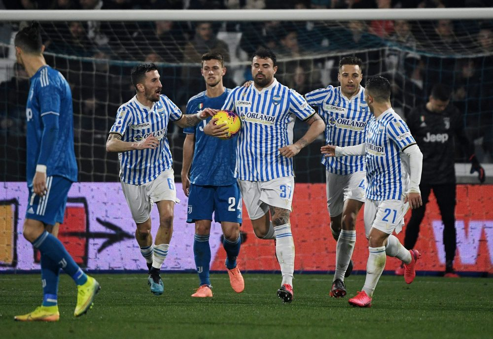 Spal's Italian forward Andrea Petagna (C) celebrates next to Juventus' Portuguese forward Cristiano Ronaldo (L) after scoring a penalty during the Italian Serie A football match SPAL vs Juventus on February 22, 2020 at the Paolo-Mazza stadium in Ferrara. (Photo by Isabella BONOTTO / AFP) (Photo by ISABELLA BONOTTO/AFP via Getty Images)