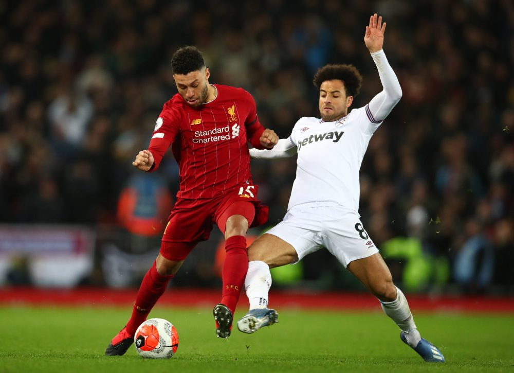 LIVERPOOL, ENGLAND - FEBRUARY 24: Alex Oxlade-Chamberlain of Liverpool is tackled by Felipe Anderson of West Ham United during the Premier League match between Liverpool FC and West Ham United at Anfield on February 24, 2020 in Liverpool, United Kingdom. (Photo by Clive Brunskill/Getty Images)