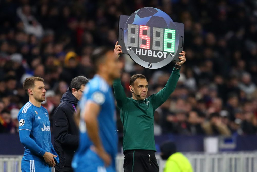 LYON, FRANCE - FEBRUARY 26: Fourth Official Guillermo Cuadra Fernandez uses the Hublot LED board to show Aaron Ramsey of Juventus being substituted on during the UEFA Champions League round of 16 first leg match between Olympique Lyon and Juventus at Parc Olympique on February 26, 2020 in Lyon, France. (Photo by Catherine Ivill/Getty Images)