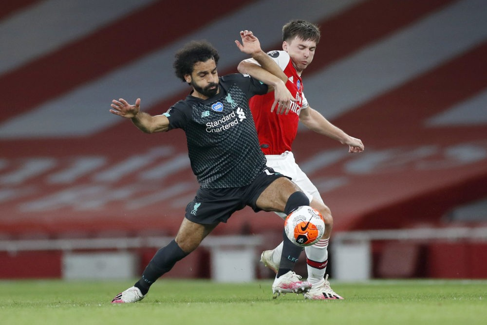 LONDON, ENGLAND - JULY 15: Mohamed Salah of Liverpool is challenged by Kieran Tierney of Arsenal during the Premier League match between Arsenal FC and Liverpool FC at Emirates Stadium on July 15, 2020 in London, England. Football Stadiums around Europe remain empty due to the Coronavirus Pandemic as Government social distancing laws prohibit fans inside venues resulting in all fixtures being played behind closed doors. (Photo by Paul Childs/Pool via Getty Images)