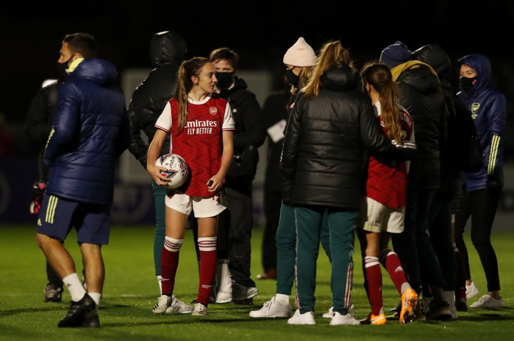 BOREHAMWOOD, ENGLAND - SEPTEMBER 26: Lisa Evans of Arsenal carries the match ball after scoring a hat trick during the SSE Women's FA Cup Quarter Final between Arsenal FC and Tottenham Hotspur FC at Meadow Park on September 26, 2020 in Borehamwood, England. Sporting stadiums around the UK remain under strict restrictions due to the Coronavirus Pandemic as Government social distancing laws prohibit fans inside venues resulting in games being played behind closed doors. (Photo by Naomi Baker/Getty Images)