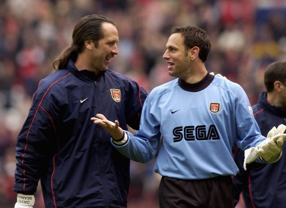14 Apr 2002: David Seaman and Richard Wright of Arsenal leave the field after the AXA FA Cup Semi Final between Arsenal and Middlesbrough at Old Trafford, Manchester. DIGITAL IMAGE. Mandatory Credit: Ross Kinnaird/Getty Images