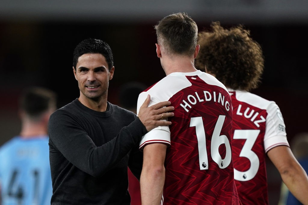 LONDON, ENGLAND - SEPTEMBER 19: Mikel Arteta, Manager of Arsenal speaks with Rob Holding of Arsenal following the Premier League match between Arsenal and West Ham United at Emirates Stadium on September 19, 2020 in London, England. (Photo by Will Oliver - Pool/Getty Images)