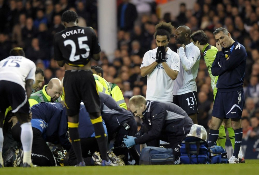Bolton Wanderer's manager Owen Coyle (R) stands beside Tottenham and Bolton players as English midfielder Fabrice Muamba is treated by medical staff after collapsing during the English FA Cup quarter-final football match between Tottenham Hotspur and Bolton Wanderers at White Hart Lane in north London, England on March 17, 2012. The game was abandoned at half-time as Muamba was taken to hospital. AFP PHOTO/OLLY GREENWOOD