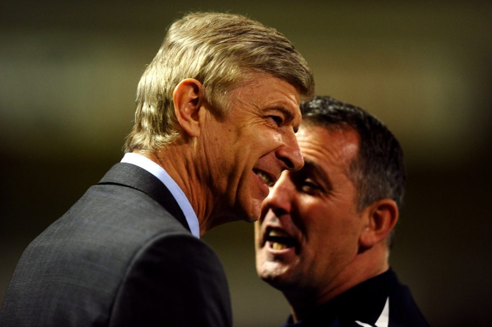 BOLTON, ENGLAND - FEBRUARY 01: Bolton Wanderers Manager Owen Coyle (R) speaks to Arsenal Manager Arsene Wenger prior to the Barclays Premier League match between Bolton Wanderers and Arsenal at the Reebok Stadium on February 1, 2012 in Bolton, England. (Photo by Laurence Griffiths/Getty Images)