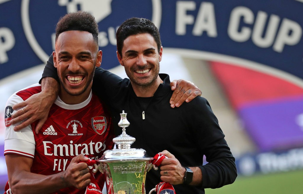 Arsenal's Gabonese striker Pierre-Emerick Aubameyang (L) and Arsenal's Spanish head coach Mikel Arteta hold the winner's trophy as the team celebrates victory after the English FA Cup final football match between Arsenal and Chelsea at Wembley Stadium in London, on August 1, 2020. - Arsenal won the match 2-1. (Photo by Catherine Ivill / POOL / AFP) / NOT FOR MARKETING OR ADVERTISING USE / RESTRICTED TO EDITORIAL USE (Photo by CATHERINE IVILL/POOL/AFP via Getty Images)