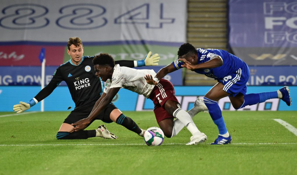 Leicester City's Ghanaian midfielder Daniel Amartey (R) vie with Arsenal's English striker Bukayo Saka (C) during the English League Cup third round football match between Leicester City and Arsenal at King Power Stadium in Leicester, central England on September 23, 2020. (Photo by RUI VIEIRA/POOL/AFP via Getty Images)