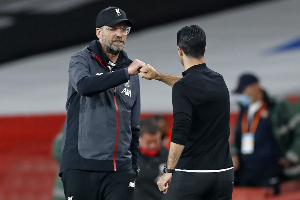 Liverpool's German manager Jurgen Klopp (L) and Arsenal's Spanish head coach Mikel Arteta gesture on the touchline after the English Premier League football match between Arsenal and Liverpool at the Emirates Stadium in London on July 15, 2020. - Arsenal won the game 2-1. (Photo by PAUL CHILDS / POOL / AFP)