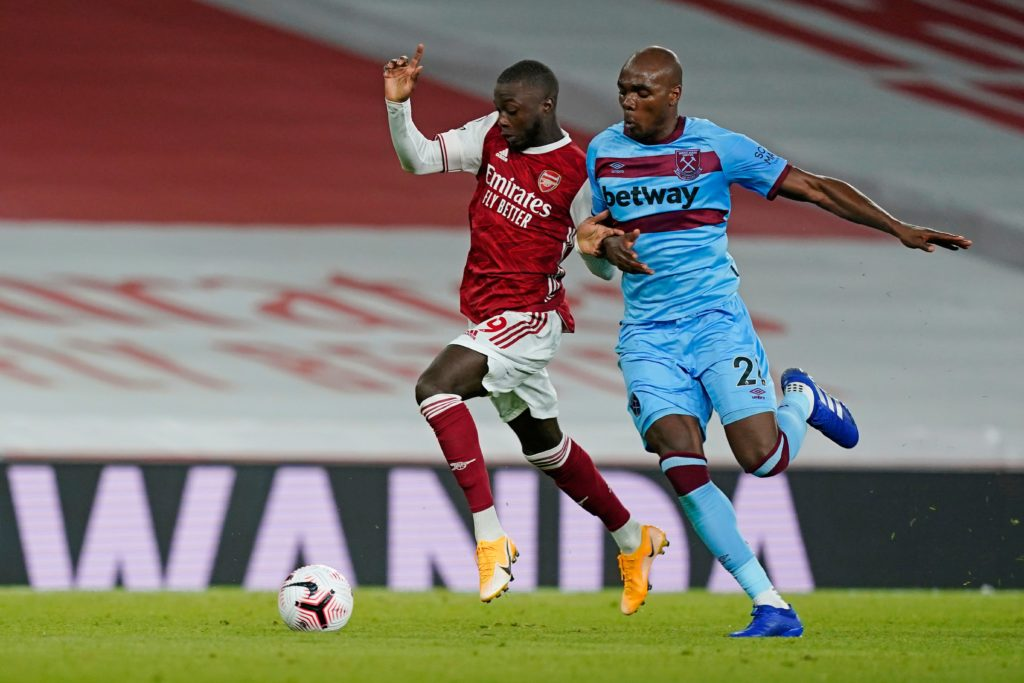Arsenal's French-born Ivorian midfielder Nicolas Pepe (L) tries to hold off West Ham United's Italian defender Angelo Ogbonna (R) during the English Premier League football match between Arsenal and West Ham United at the Emirates Stadium in London on September 19, 2020. (Photo by WILL OLIVER/POOL/AFP via Getty Images)