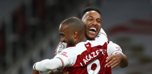 Arsenal's French striker Alexandre Lacazette (L) celebrates scoring the opening goal with Arsenal's Gabonese striker Pierre-Emerick Aubameyang (R) who provided the assist during the English Premier League football match between Arsenal and West Ham United at the Emirates Stadium in London on September 19, 2020. (Photo by Julian Finney / POOL / AFP)