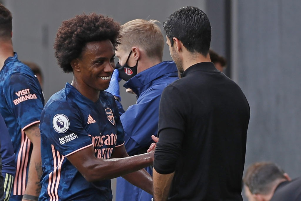 Arsenal's Brazilian midfielder Willian (L) shakes hands with Arsenal's Spanish first-team manager Mikel Arteta (R) after coming off substituted during the English Premier League football match between Fulham and Arsenal at Craven Cottage in London on September 12, 2020. (Photo by PAUL CHILDS / POOL / AFP)