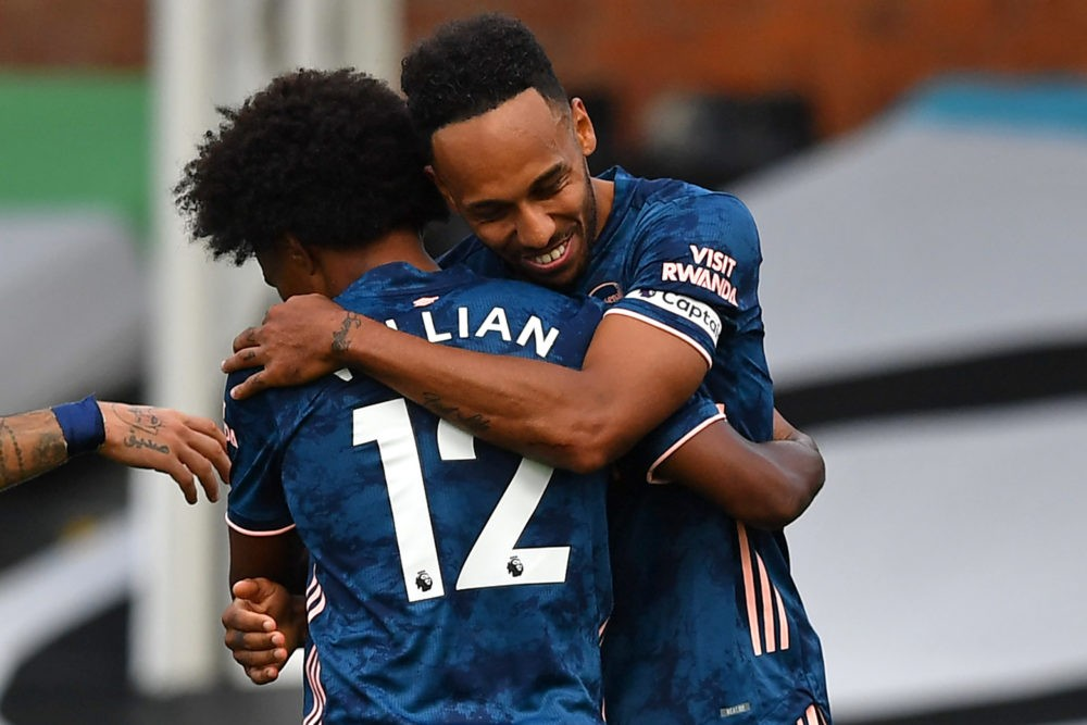Arsenal's Gabonese striker Pierre-Emerick Aubameyang (R) celebrates scoring their third goal with Arsenal's Brazilian midfielder Willian (L) during the English Premier League football match between Fulham and Arsenal at Craven Cottage in London on September 12, 2020. (Photo by Ben STANSALL / POOL / AFP)