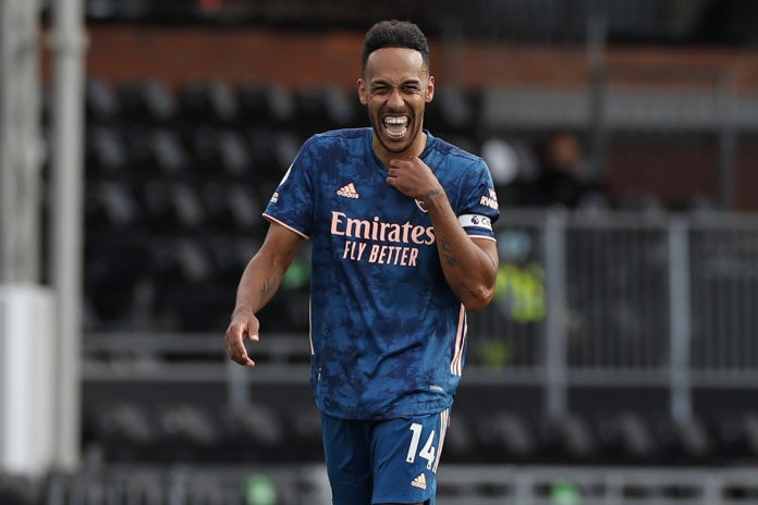 Arsenal's Gabonese striker Pierre-Emerick Aubameyang celebrates scoring their third goal during the English Premier League football match between Fulham and Arsenal at Craven Cottage in London on September 12, 2020. (Photo by PAUL CHILDS / POOL / AFP) / RESTRICTED TO EDITORIAL USE. No use with unauthorized audio, video, data, fixture lists, club/league logos or 'live' services. Online in-match use limited to 120 images. An additional 40 images may be used in extra time. No video emulation. Social media in-match use limited to 120 images. An additional 40 images may be used in extra time. No use in betting publications, games or single club/league/player publications. / (Photo by PAUL CHILDS/POOL/AFP via Getty Images)