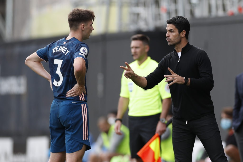 Arsenal's Spanish first-team manager Mikel Arteta (R) talks with Arsenal's Scottish defender Kieran Tierney (L) on the touchline during the English Premier League football match between Fulham and Arsenal at Craven Cottage in London on September 12, 2020. (Photo by PAUL CHILDS / POOL / AFP)