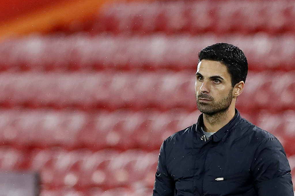 Arsenal's Spanish manager Mikel Arteta watches his players from the touchline during the English Premier League football match between Liverpool and Arsenal at Anfield in Liverpool, north west England on September 28, 2020. (Photo by JASON CAIRNDUFF / POOL / AFP) / RESTRICTED TO EDITORIAL USE. No use with unauthorized audio, video, data, fixture lists, club/league logos or 'live' services. Online in-match use limited to 120 images. An additional 40 images may be used in extra time. No video emulation. Social media in-match use limited to 120 images. An additional 40 images may be used in extra time. No use in betting publications, games or single club/league/player publications. / (Photo by JASON CAIRNDUFF/POOL/AFP via Getty Images)