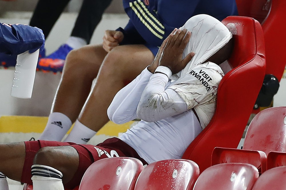 Arsenal's French striker Alexandre Lacazette reacts after being substituted off during the English Premier League football match between Liverpool and Arsenal at Anfield in Liverpool, north west England on September 28, 2020. (Photo by JASON CAIRNDUFF / POOL / AFP)