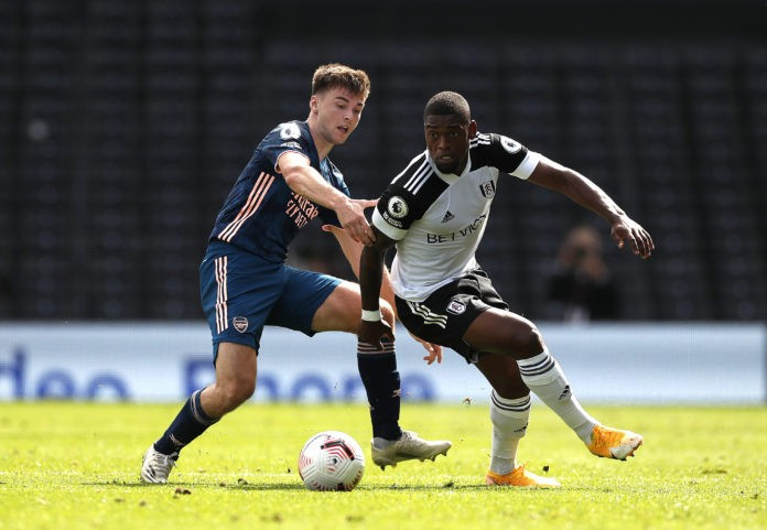 LONDON, ENGLAND - SEPTEMBER 12: Ivan Cavaleiro of Fulham is challenged by Kieran Tierney of Arsenal during the Premier League match between Fulham and Arsenal at Craven Cottage on September 12, 2020 in London, England. (Photo by Paul Childs - Pool/Getty Images)