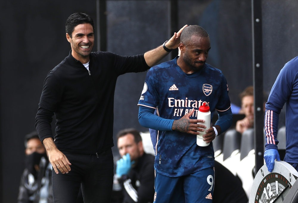 LONDON, ENGLAND - SEPTEMBER 12: Mikel Arteta, Manager of Arsenal interacts with Alexandre Lacazette of Arsenal after he is subbed during the Premier League match between Fulham and Arsenal at Craven Cottage on September 12, 2020 in London, England. (Photo by Paul Childs - Pool/Getty Images)