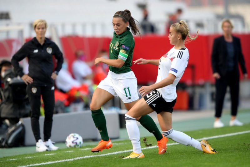 ESSEN, GERMANY - SEPTEMBER 19: Giulia Gwinn of Germany (R) challenges Katie McCabe of Ireland (L) during the UEFA Women's EURO 2022 Qualifier match between Germany and Ireland at Stadion Essen on September 19, 2020 in Essen, Germany. (Photo by Christof Koepsel/Getty Images)