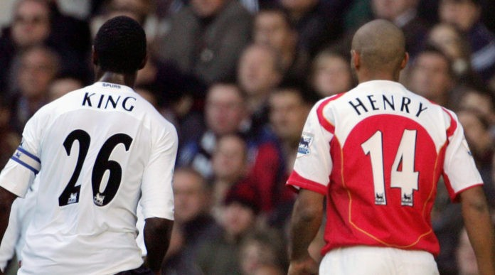 LONDON, UNITED KINGDOM: Ledley King (L) of Tottenham follows Arsenal's Thierry Henry (R) across the field during their Premiership match at White Hart Lane in London 13 November 2004. Both players scored in the game with Arsenal winning the match 5-4. AFP PHOTO Adrian DENNIS