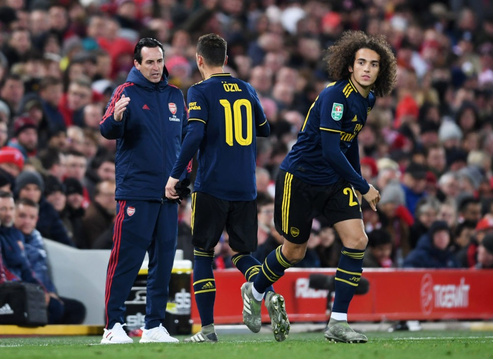 LIVERPOOL, ENGLAND - OCTOBER 30: Mesut Ozil of Arsenal shakes hands with Unai Emery, Manager of Arsenal as he is substituted for Matteo Guendouzi of Arsenal during the Carabao Cup Round of 16 match between Liverpool and Arsenal at Anfield on October 30, 2019 in Liverpool, England. (Photo by Laurence Griffiths/Getty Images)