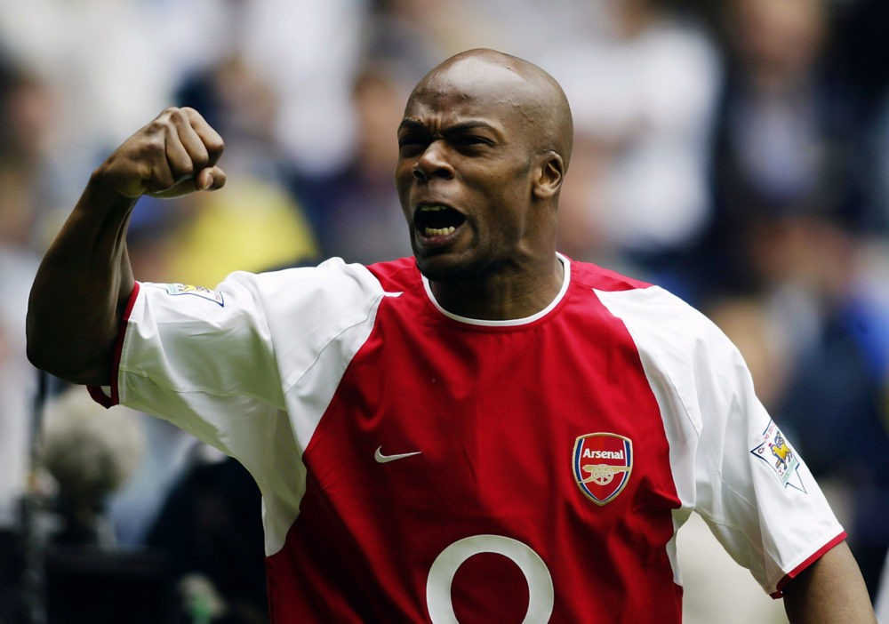 BOLTON - APRIL 26: Sylvain Wiltord of Arsenal celebrates after scoring the first goal during the FA Barclaycard Premiership match between Bolton Wanderers and Arsenal held on April 26, 2003 at the Reebok Stadium in Bolton, England. The match ended in a 2-2 draw. (Photo by Gary M. Prior/Getty Images)