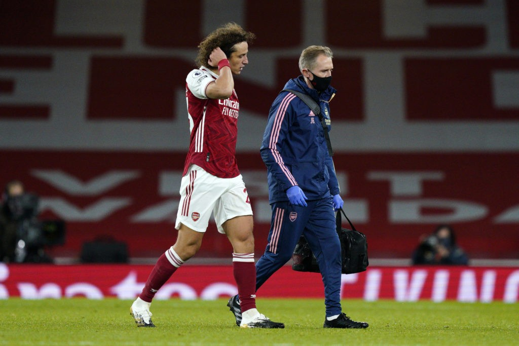 LONDON, ENGLAND: David Luiz of Arsenal leaves the pitch injured during the Premier League match between Arsenal and Leicester City at Emirates Stadium on October 25, 2020. (Photo by Will Oliver - Pool/Getty Images)