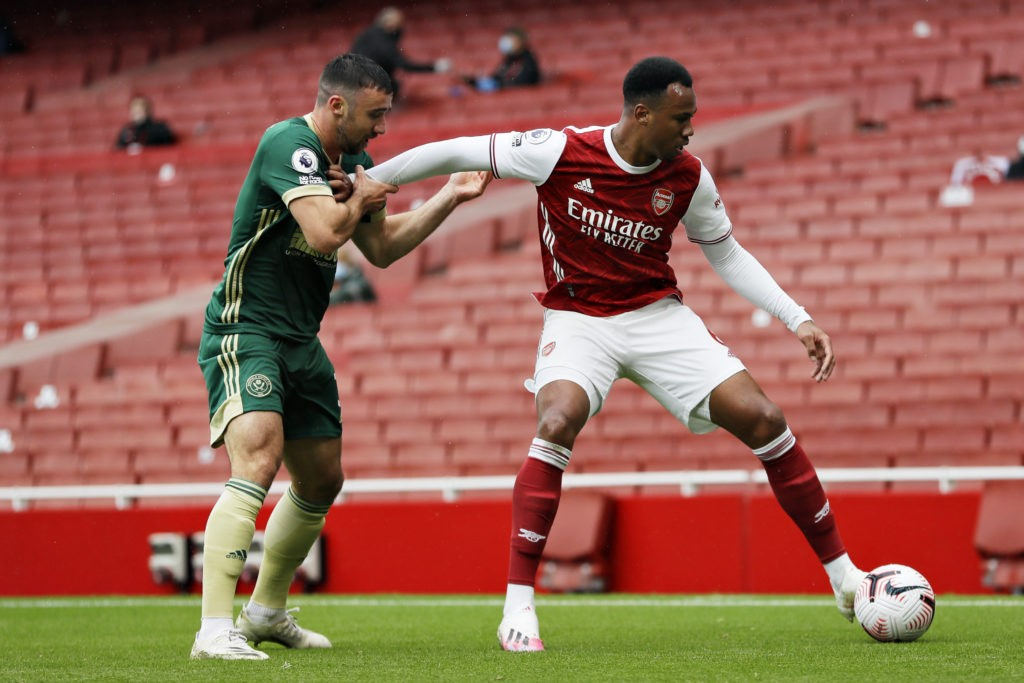 LONDON, ENGLAND - OCTOBER 04: Gabriel of Arsenal holds off Enda Stevens of Sheffield United during the Premier League match between Arsenal and Sheffield United at Emirates Stadium on October 04, 2020 in London, England. (Photo by Kirsty Wigglesworth - Pool/Getty Images)