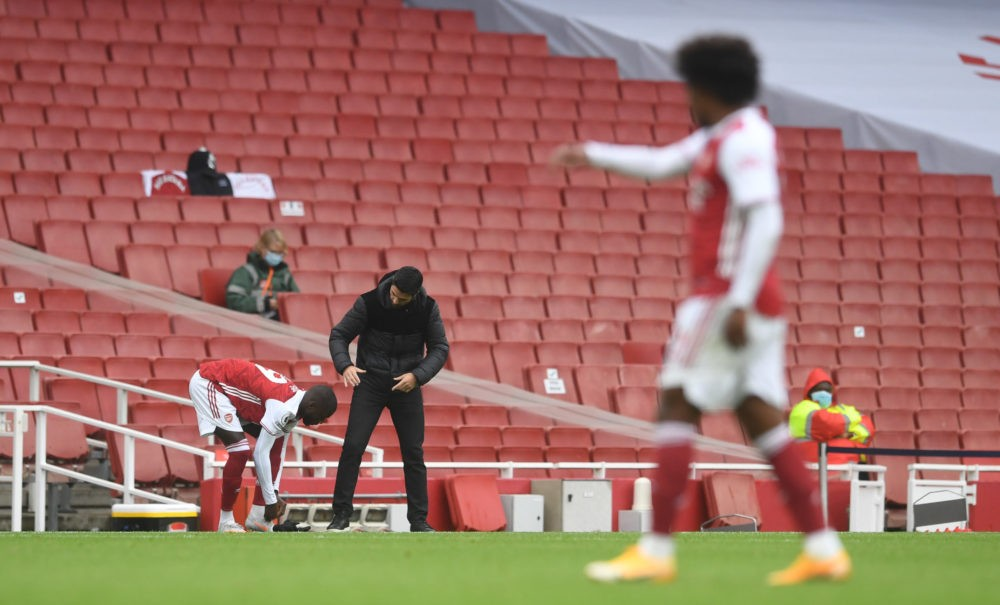 LONDON, ENGLAND - OCTOBER 04: Mikel Arteta, Manager of Arsenal talks to Nicolas Pepe of Arsenal as he is sub during the Premier League match between Arsenal and Sheffield United at Emirates Stadium on October 04, 2020 in London, England. Sporting stadiums around the UK remain under strict restrictions due to the Coronavirus Pandemic as Government social distancing laws prohibit fans inside venues resulting in games being played behind closed doors. (Photo by Neil Hall - Pool/Getty Images)