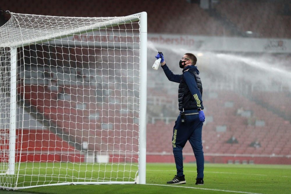 LONDON, ENGLAND: A member of staff disinfects the goal posts amidst the COVID-19 pandemic prior to the Premier League match between Arsenal and West Ham United at Emirates Stadium on September 19, 2020. (Photo by Ian Walton - Pool/Getty Images)