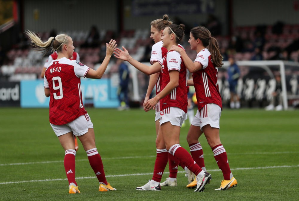 BOREHAMWOOD, ENGLAND - OCTOBER 18: Caitlin Foord of Arsenal celebrates with teammates after scoring her team's third goal during the Barclays FA Women's Super League match between Arsenal Women and Tottenham Hotspur Women at Meadow Park on October 18, 2020 in Borehamwood, England. Sporting stadiums around the UK remain under strict restrictions due to the Coronavirus Pandemic as Government social distancing laws prohibit fans inside venues resulting in games being played behind closed doors. (Photo by Catherine Ivill/Getty Images)