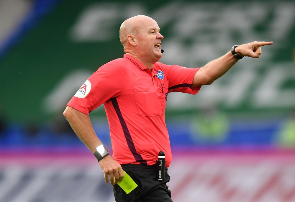 LIVERPOOL, ENGLAND - JULY 09: Referee Lee Mason reaches for his yellow card during the Premier League match between Everton FC and Southampton FC at Goodison Park on July 09, 2020 in Liverpool, England. Football Stadiums around Europe remain empty due to the Coronavirus Pandemic as Government social distancing laws prohibit fans inside venues resulting in all fixtures being played behind closed doors. (Photo by Michael Regan/Getty Images)