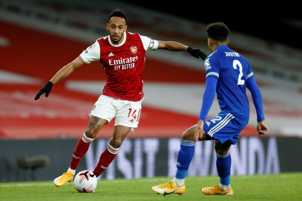 Leicester City's English defender James Justin (R) vies with Arsenal's Gabonese striker Pierre-Emerick Aubameyang during the English Premier League football match between Arsenal and Leicester City at the Emirates Stadium in London on October 25, 2020. (Photo by IAN KINGTON/IKIMAGES/AFP via Getty Images)