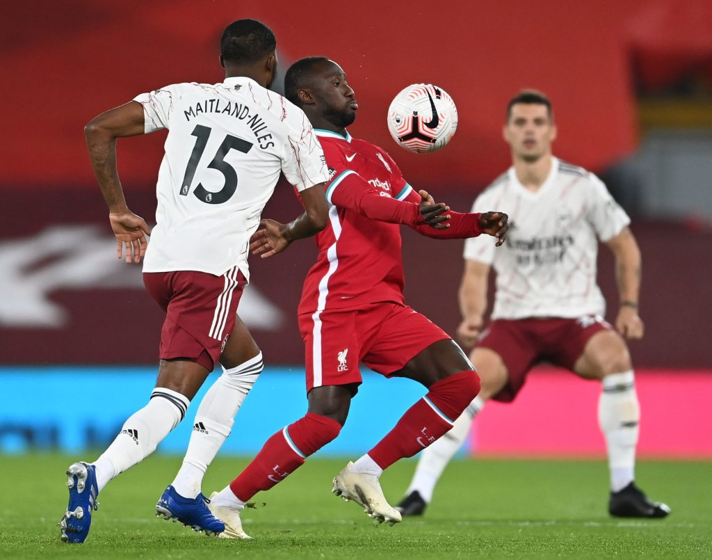 Arsenal's English midfielder Ainsley Maitland-Niles (L) vies with Liverpool's Guinean midfielder Naby Keita during the English Premier League football match between Liverpool and Arsenal at Anfield in Liverpool, north west England on September 28, 2020. (Photo by LAURENCE GRIFFITHS/POOL/AFP via Getty Images)